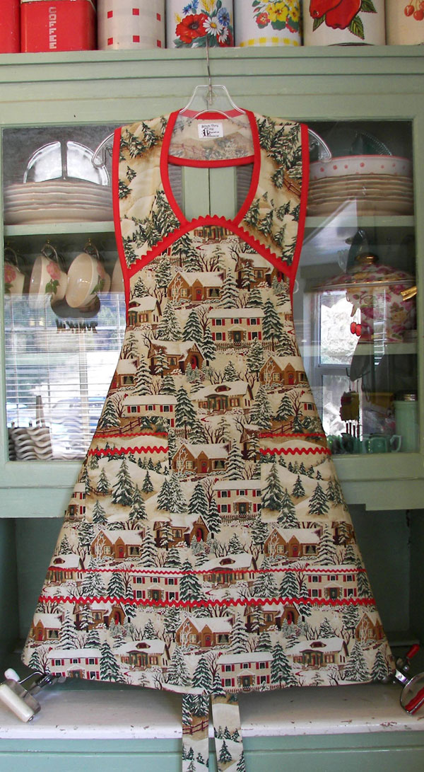 Old Time Village Christmas Apron with red trim and ric rac
