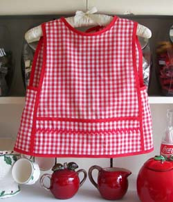 Small child apron in red gingham